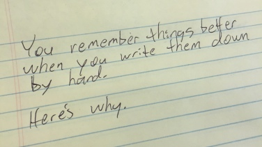"A piece of paper with the written sentence: ""You remember things better when you write them down by hand. Here's why."""